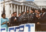 Mickey Leland ; Ron Dellums, others on congress lawn for South Africa Override of President Reagan's Veto of South Africa Sanctions bill