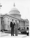 Mickey Leland on steps of the US Capitol with Intern Doug Dan