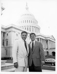 Mickey Leland with Newt Gringrich Todd Franfurt on steps of Capitol by The Mickey Leland Papers & Collection Addendum. (Texas Southern University, 2018)