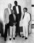 Mickey Leland posing with Manute Bol of the Golden State Warriors with other members by The Mickey Leland Papers & Collection Addendum. (Texas Southern University, 2018)