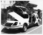 Mickey Leland reviews electric car ; Unknown others