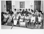 Mickey Leland with elderly black constiuents ; Unknown others