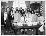 Mickey Leland at office desk with Houston close-up Students